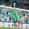 Manchester City's Joe Hart tips the ball over the bar
