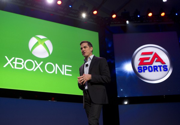 Andrew Wilson, Executive Vice President at EA Sports, unveils a new lineup of EA Sports game coming to Xbox One during Xbox reveal event, on Tuesday, May 21, 2013, in Redmond, Wash. (Photo by Stephen Brashear/Invision for Microsoft/AP Images)